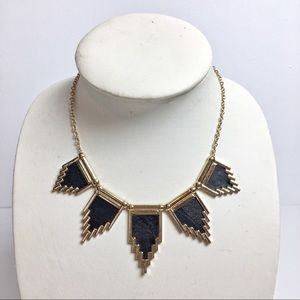 Brass necklace with black faux leather accents